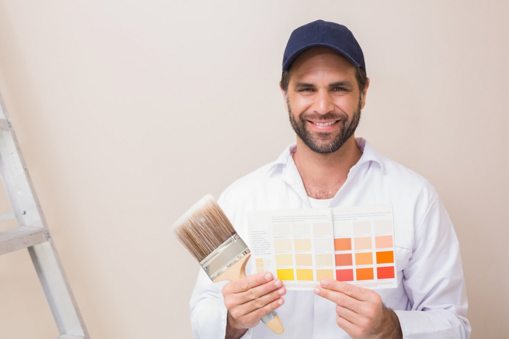 Painter holding colour selection chart